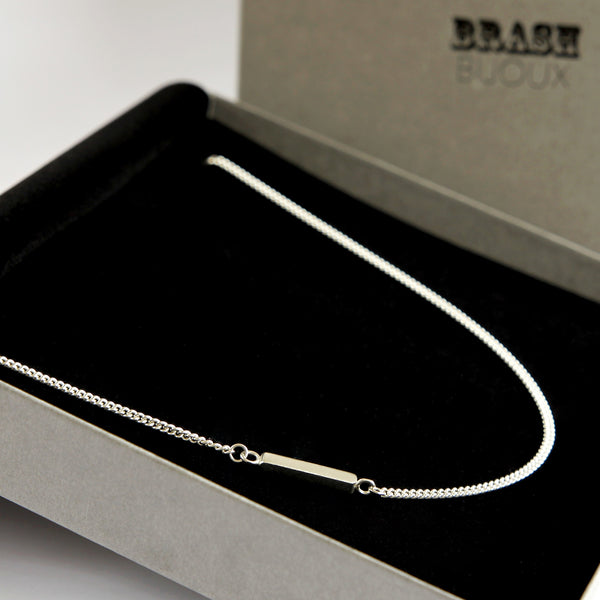 Sterling silver curb chain necklace with a textured bar in branded gift box