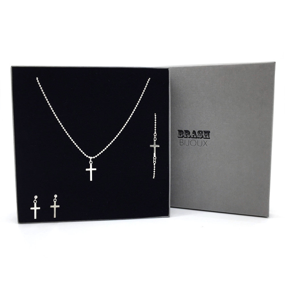 The ultimate cross set from Brash Bijoux. The set features a chain with cross pendant, Sideways cross on bracelet and a pair of crosses dangling from ball studs.