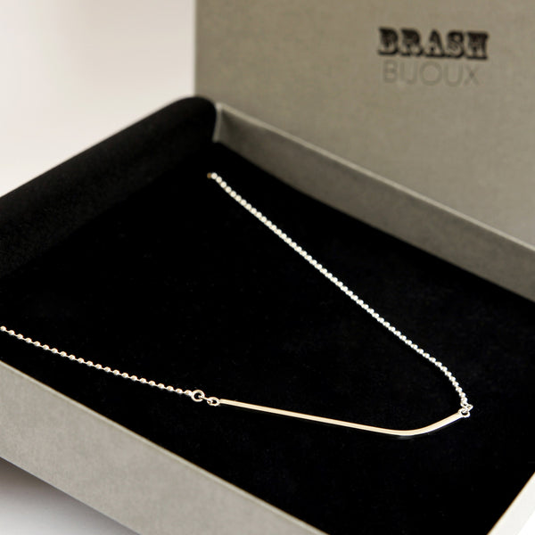 Sterling silver ball chain necklace with a curved square wire bar in branded gift box