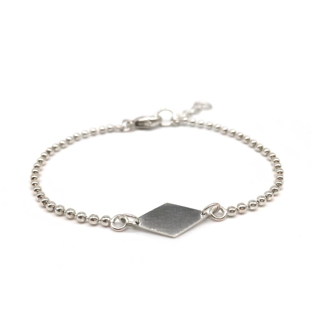 The Diamond Bracelet. A hand-cut silver diamond shape is attached to a silver ball chain and comes with an extend chain.