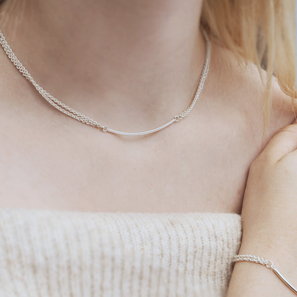 Sterling silver double chain necklace, created using double chains attached to a 3cm solid bar, slightly curved to sit perfectly. Picture shown on model.