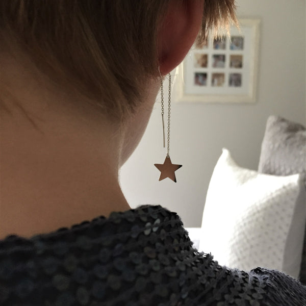 Star Dangle Earrings as shown on the model. The perfect party earrings