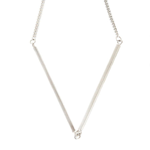 Stand out from the crowd with the V Bar Necklace. Made from solid silver the bars are attached to a nice weight chain.