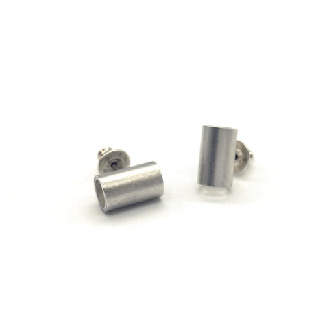 These Brash Bijoux Tube Studs are made from solid sterling silver. Made to create an impact to the wearer.