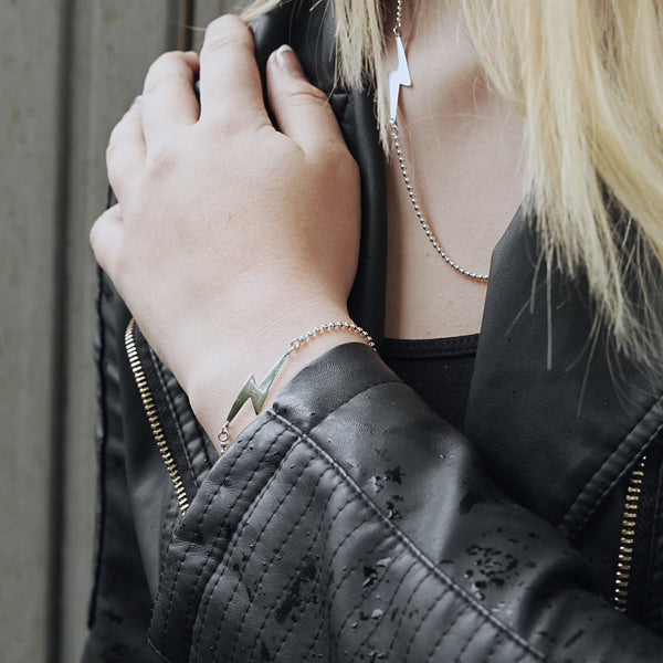 Sterling silver lightning bolt bracelet, the bolt is hand-cut and then attached to the 2mm ball chain.  Love Bowie, you will love this bracelet! Picture shown with bracelet on model