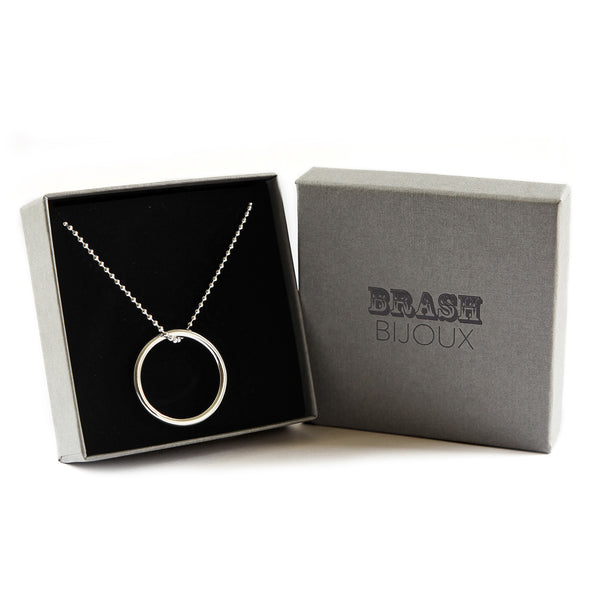 Silver ball chain necklace with a solid large ring pendant
