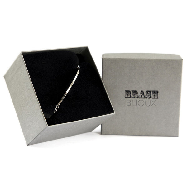 The curved bar bracelet shown in gift box