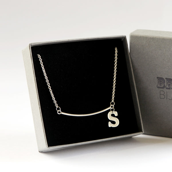 Personalised sterling silver necklace with hand-cut letter in branded gift box