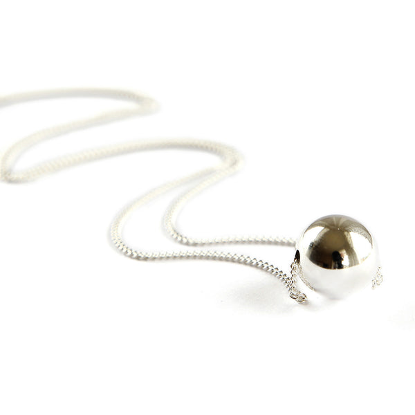 A nice long curb chain necklace with a large silver ball