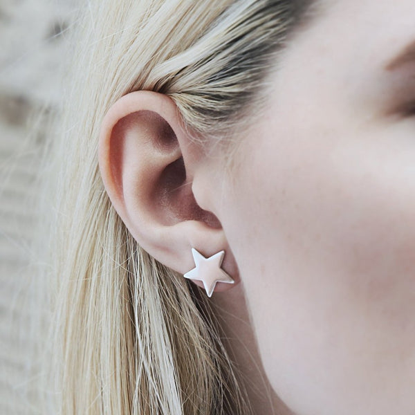 Silver star studs on model. Great for showing your star quality