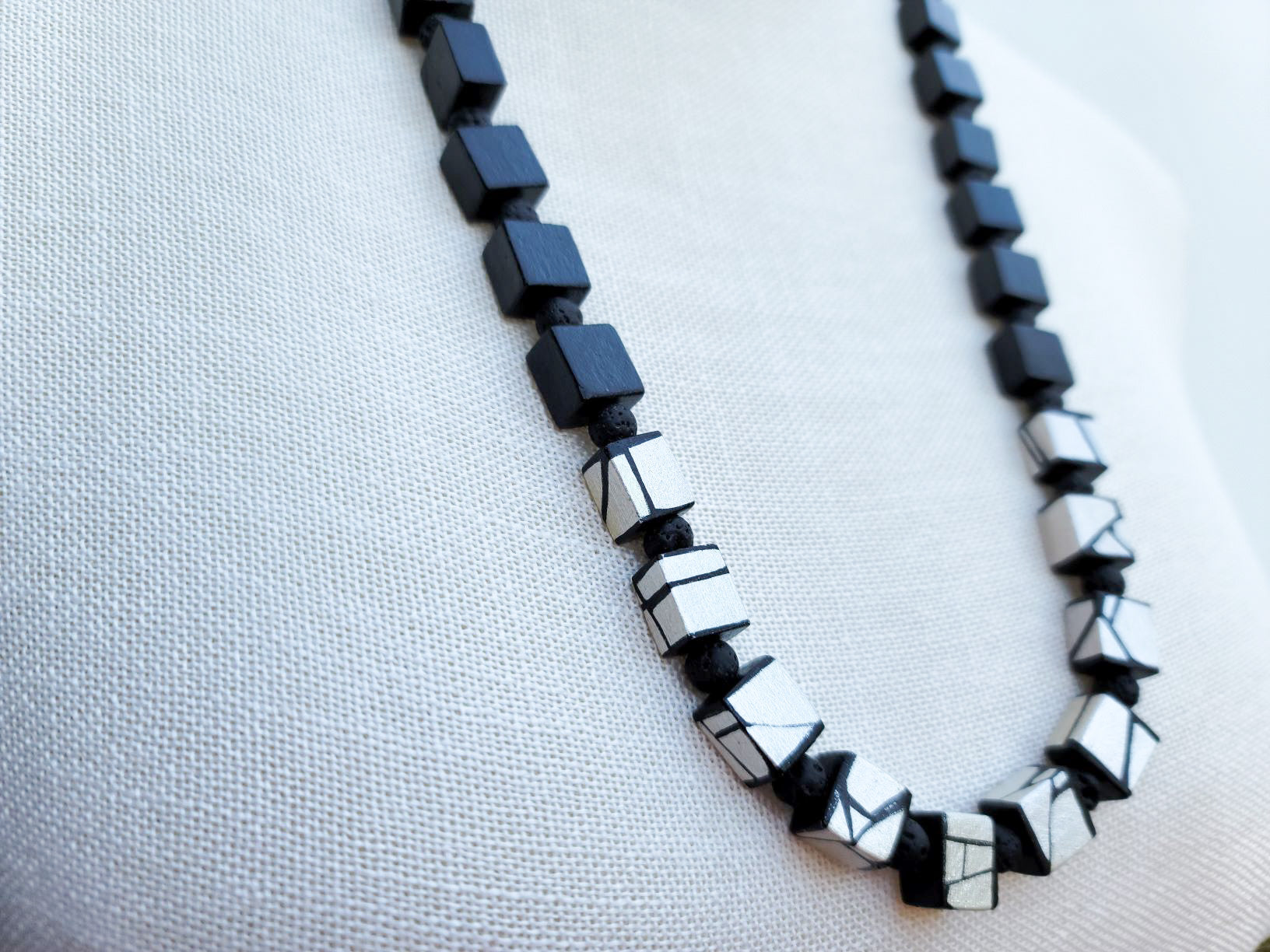 Painted wood bead necklace in black and white