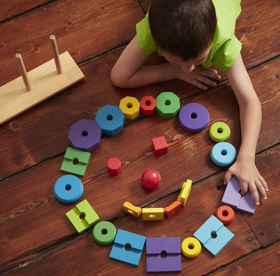 Wooden Geometric Stacker Toddler Toy