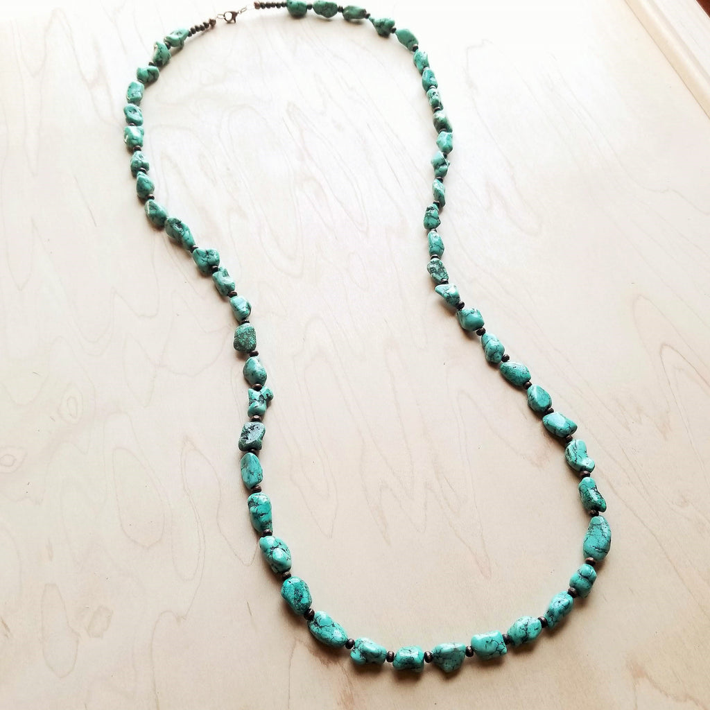 A long turquoise necklace with wooden beads from The Jewelry Junkie.