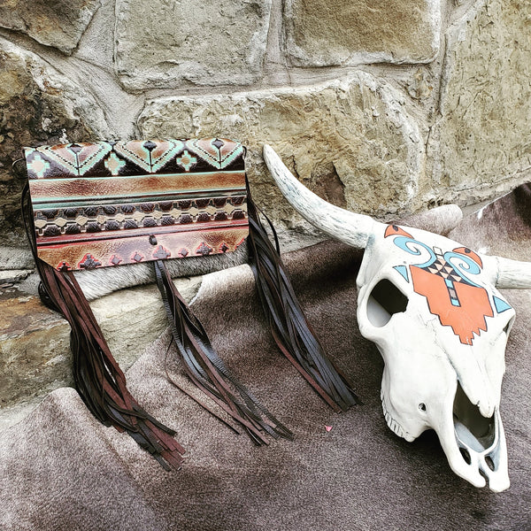 A boho leather clutch with Navajo pattern flap from Jewelry Junkie