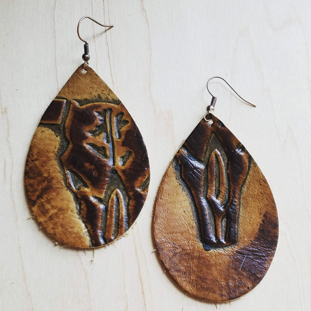 A pair of handmade leather earrings from The Jewelry Junkie.