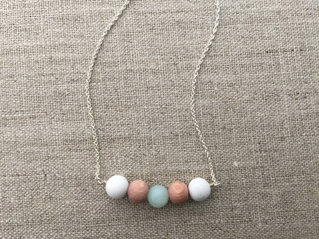 white beaded diffuser necklace