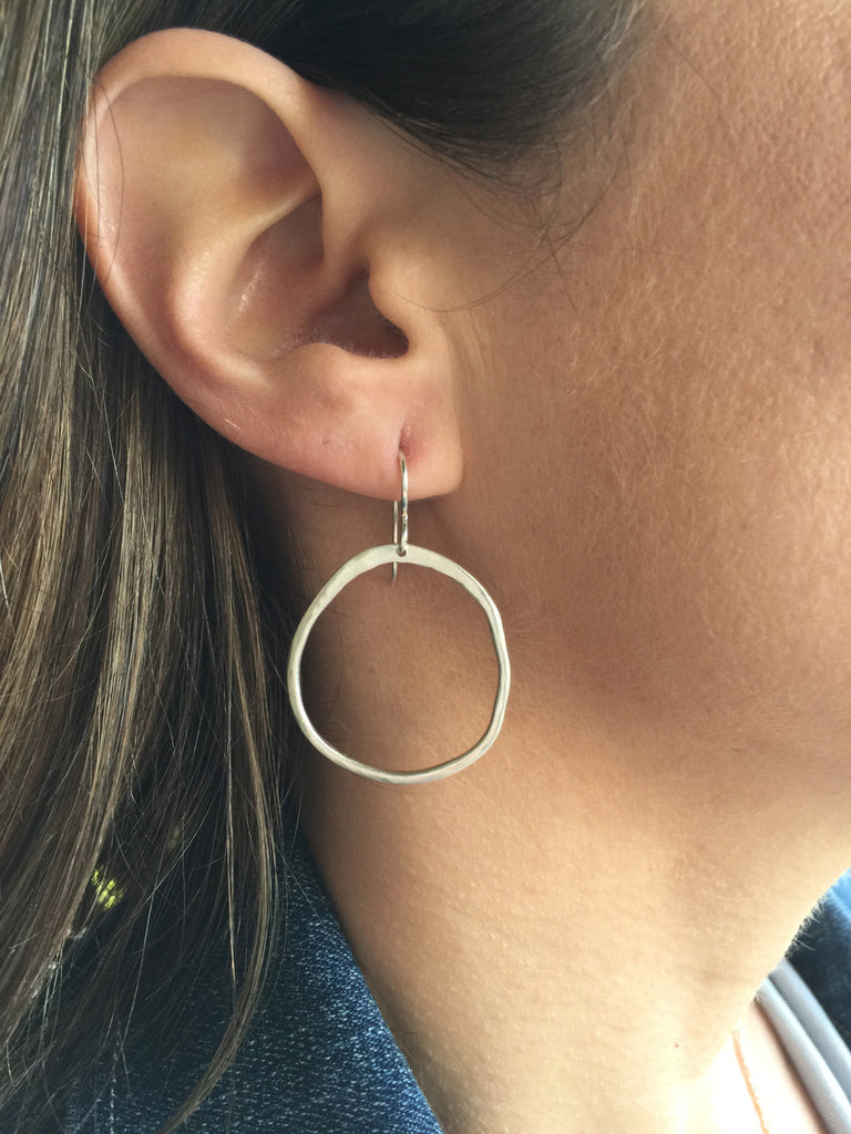 large rippled circle earrings on model