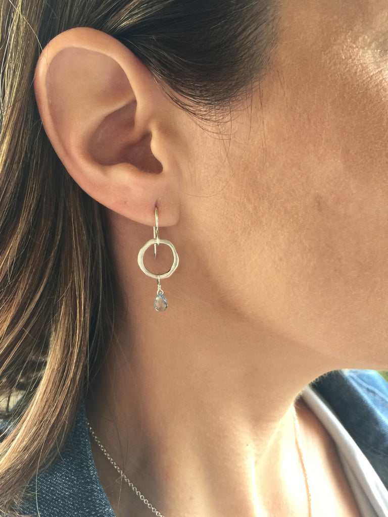 silver and blue topaz earrings on model