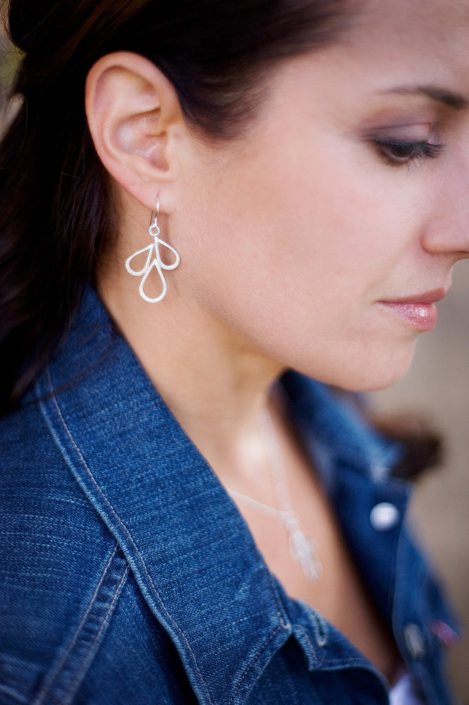 hammered silver leaves earrings on model