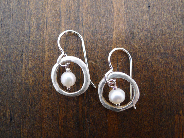silver circle with pearls earrings