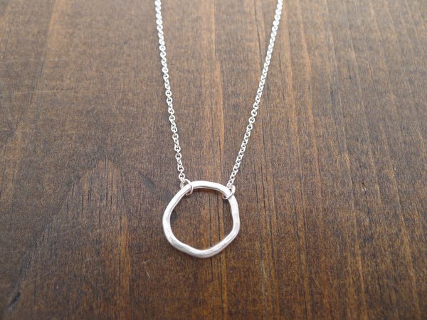 silver rippled circle necklace