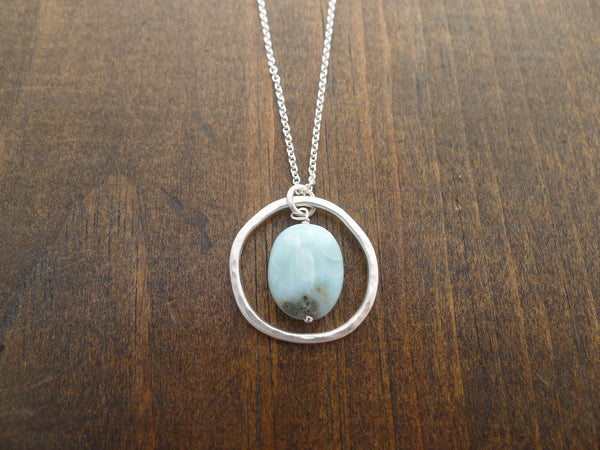 Silver rippled circle with larimar necklace