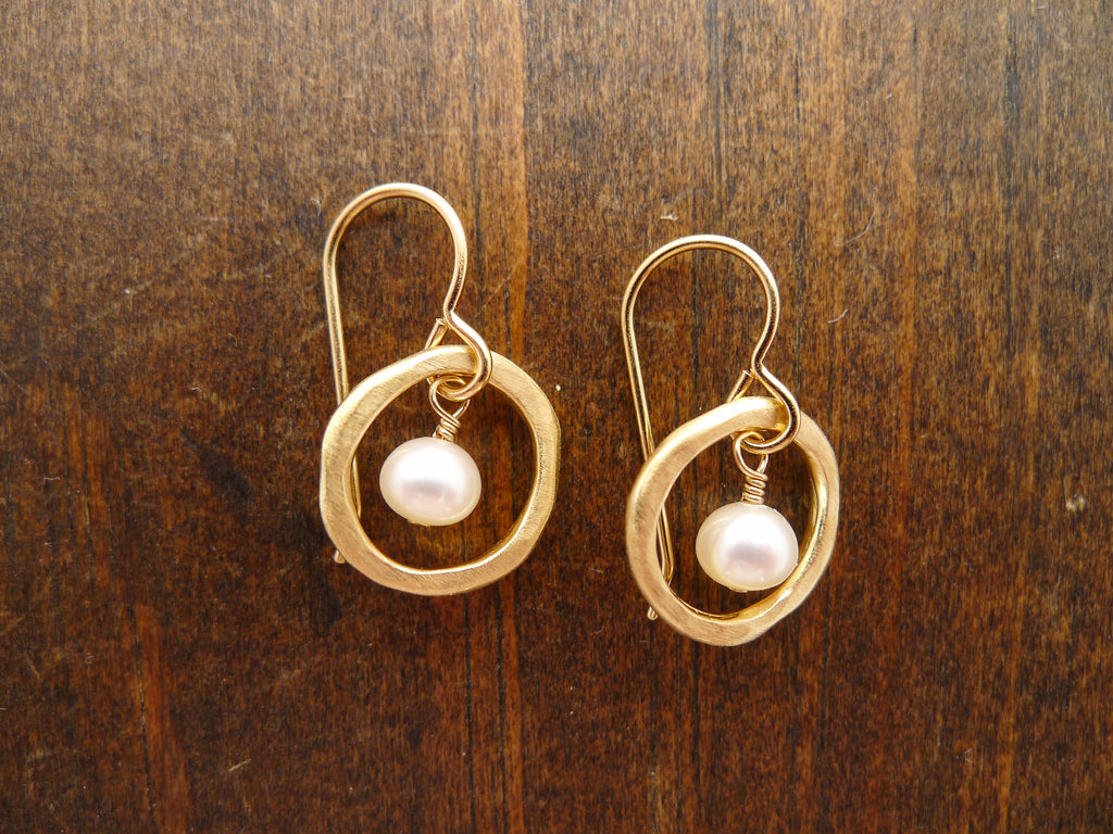gold circles with pearl earrings