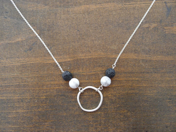 circle diffuser necklace with howlite and lava