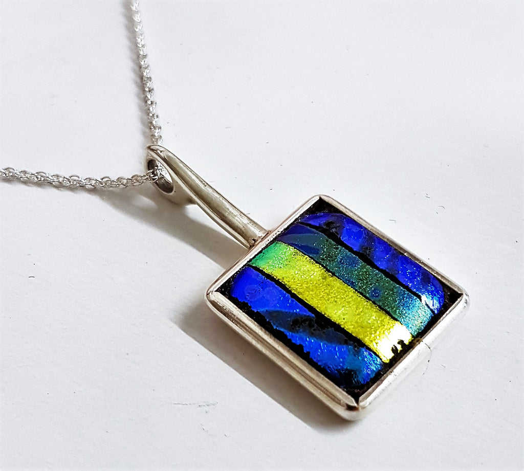 New sterling silver and dichroic design pendant.