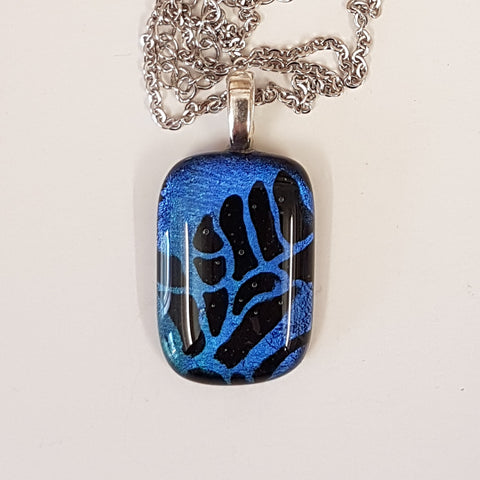 Etched dichroic pendant.