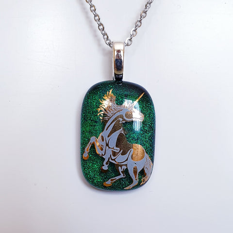 Gold and white enamel image Unicorn Pendant.