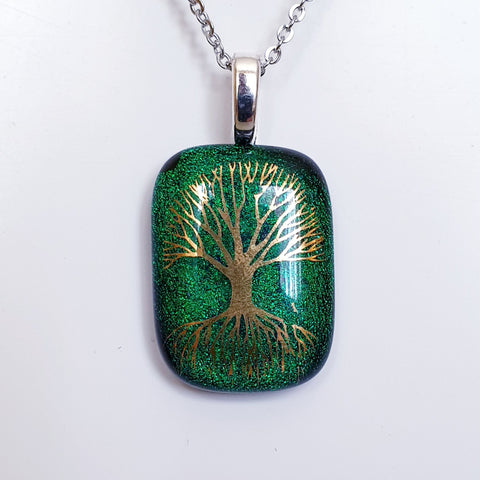 Golden tree of life enamel image glass pendant.