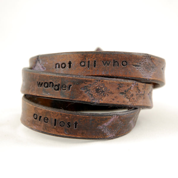 Triple wrap leather bracelet stamped with repeating Not All Who Wander Are Lost