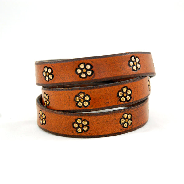 Triple wrap leather bracelet stamped with repeating flower pattern