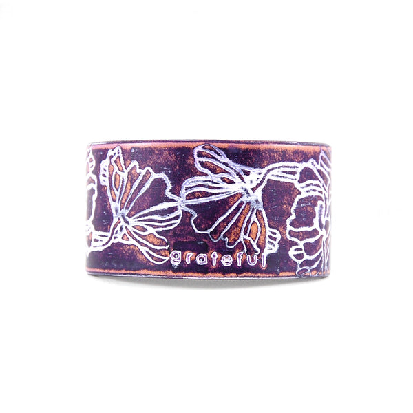 Embossed leather cuff bracelet stamped with the word Grateful finished in purple and white