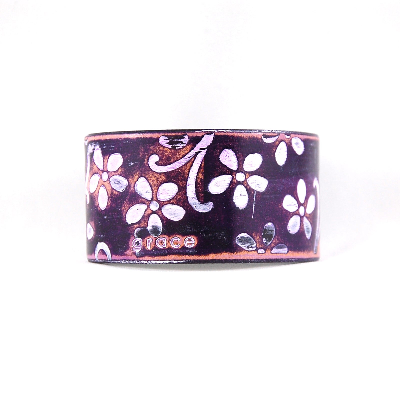 Embossed leather cuff bracelet stamped with the word Grace finished in purple and white