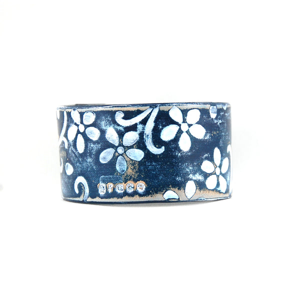 Embossed leather cuff bracelet stamped with the word Grace finished in blue and white