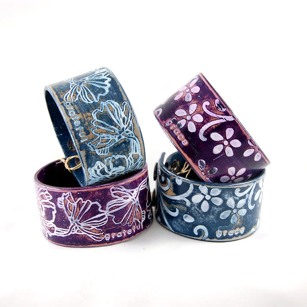 Embossed leather cuff bracelet stamped with the word Grateful or Grace finished in blue and white or purple and white