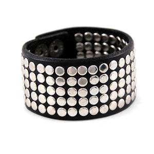 The rocker 130 stunning handmade leather cuff with 130 handset metal rivets.