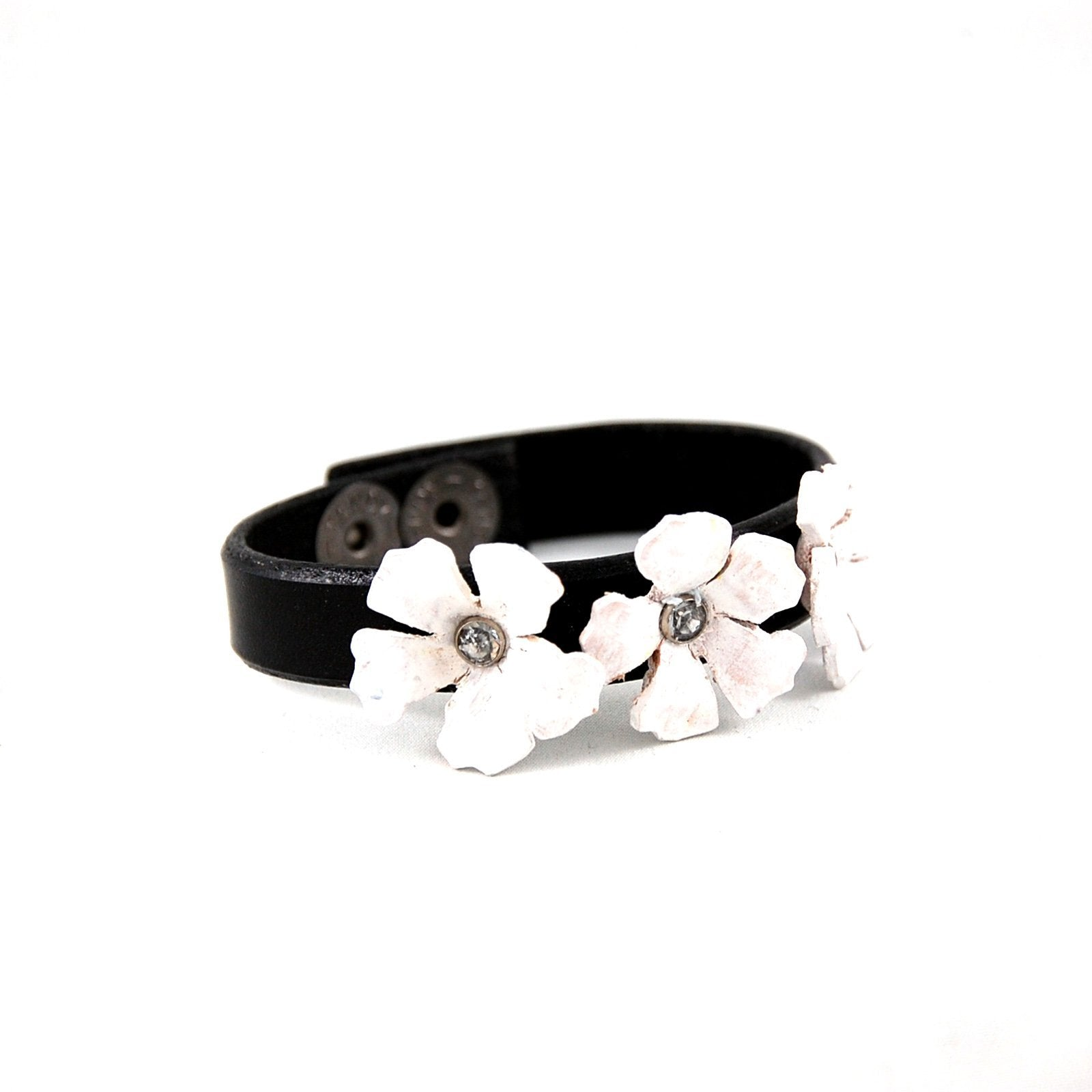 Handmade leather cuff bracelet with a 3 white hand sculpted leather flowers