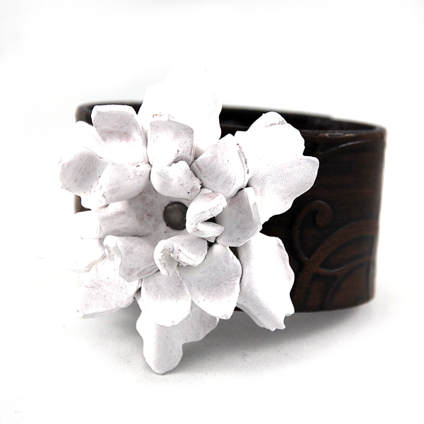 Handmade leather cuff bracelet with a hand sculpted leather flower in a variety of vibrant colors.