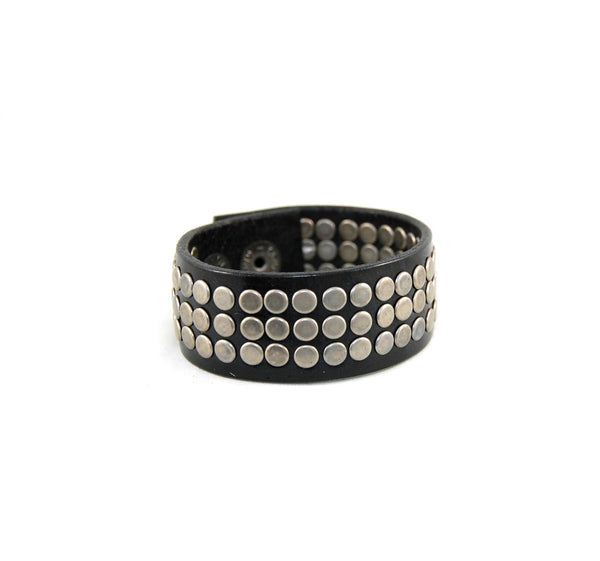 The rocker 78 handmade leather cuff with 78 handset metal rivets black with nickle rivets
