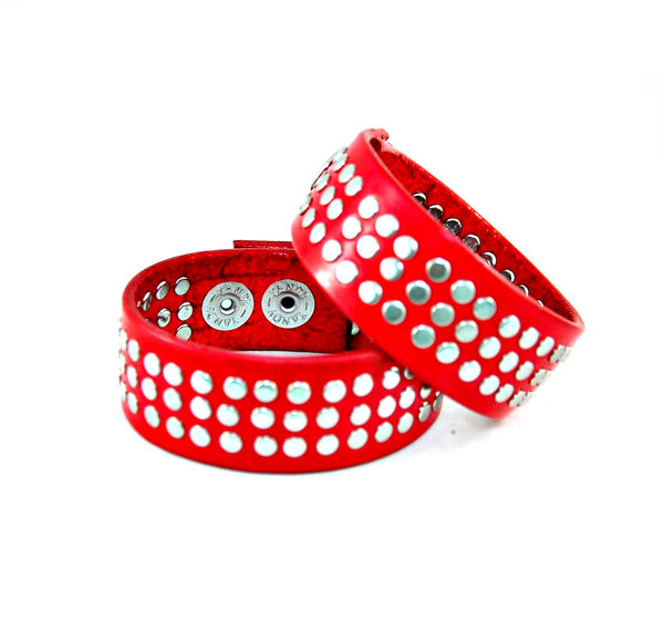 The rocker 78 handmade leather cuff with 78 handset metal rivets red with nickel rivets