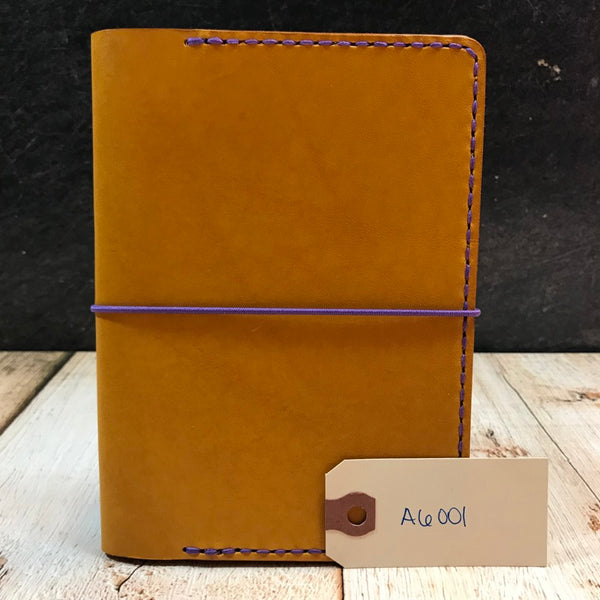 A6 Notebook Cover in Yellow Buttero with Purple Thread