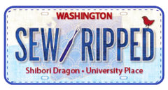 SEW RIPPED LICENSE PLATE