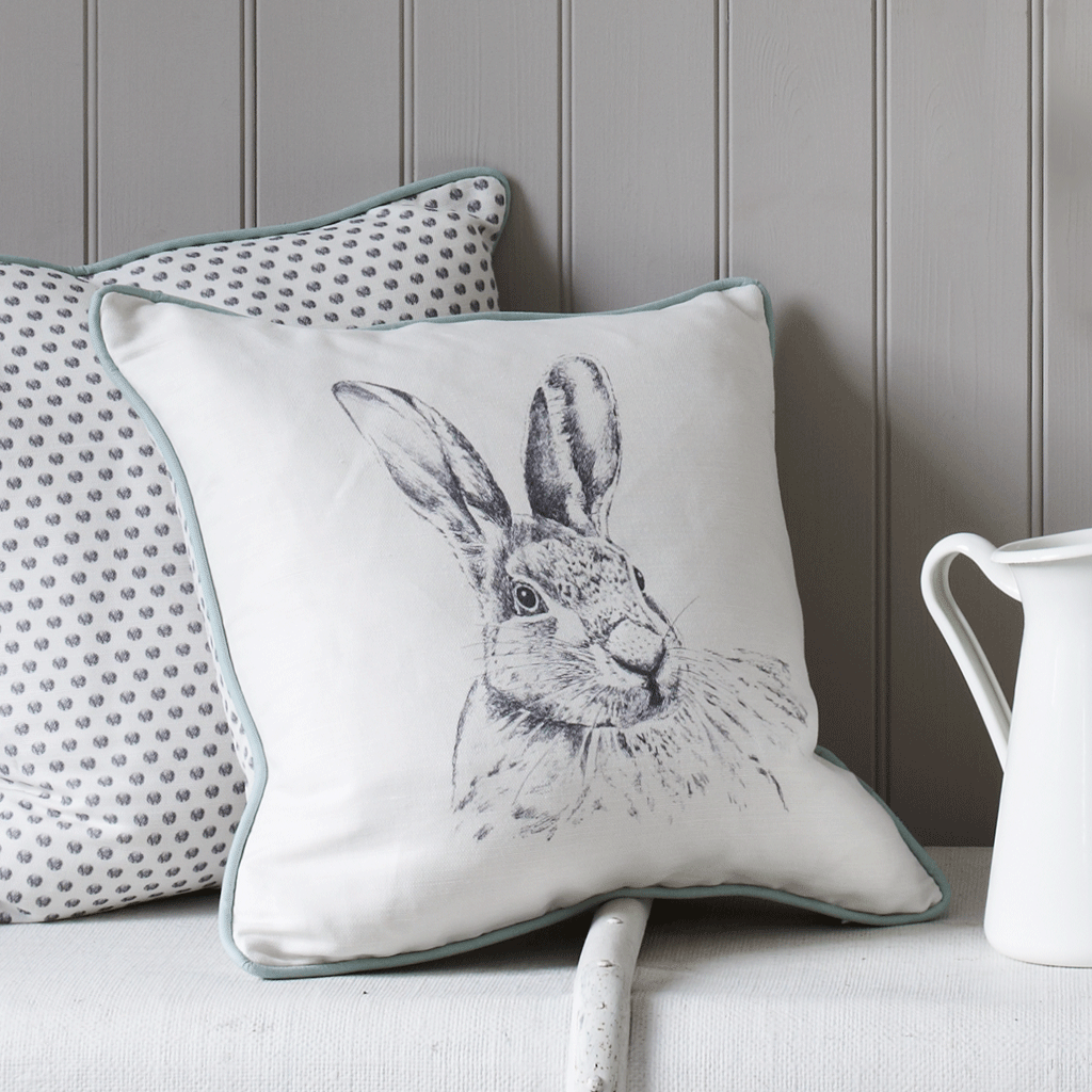grey hand painted hare rabbit cushion with polka dot reverse - stil haven