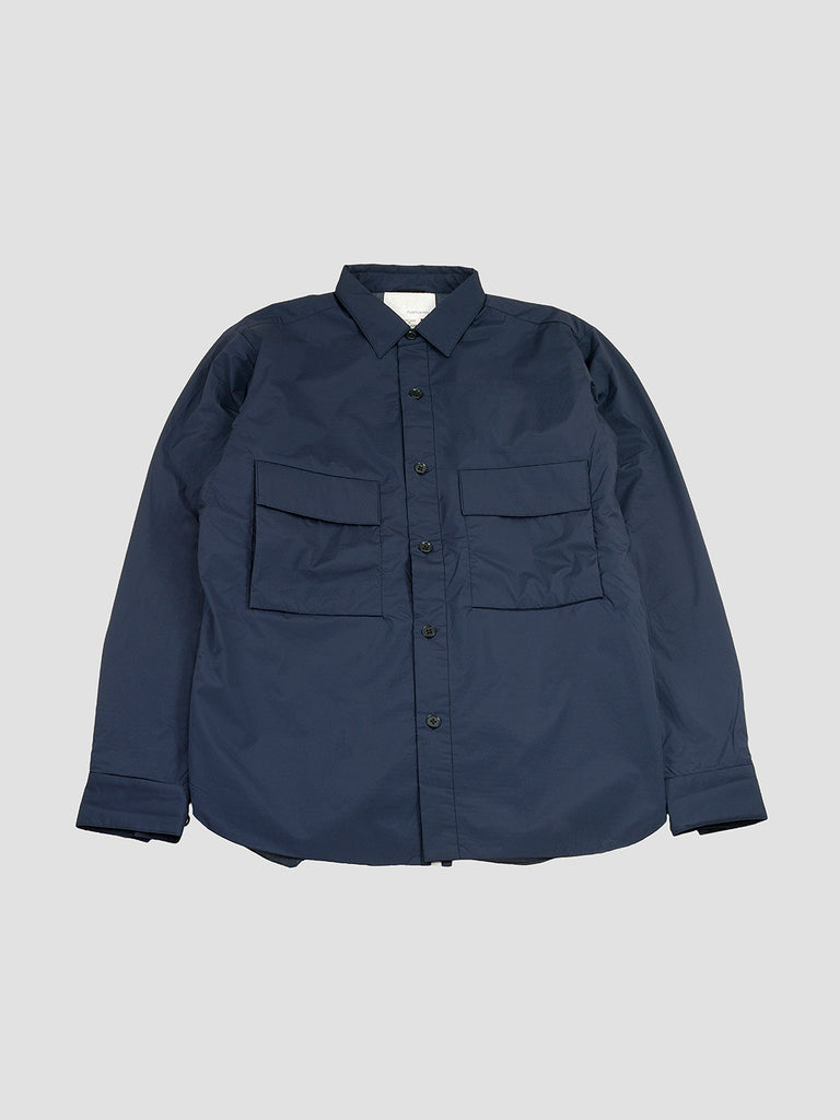 Insulation shirt in navy by Nanamica