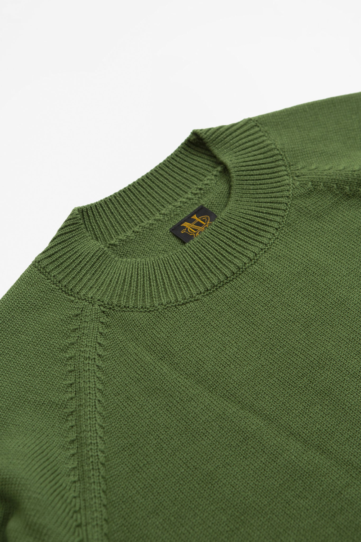 Aging wool crew neck green