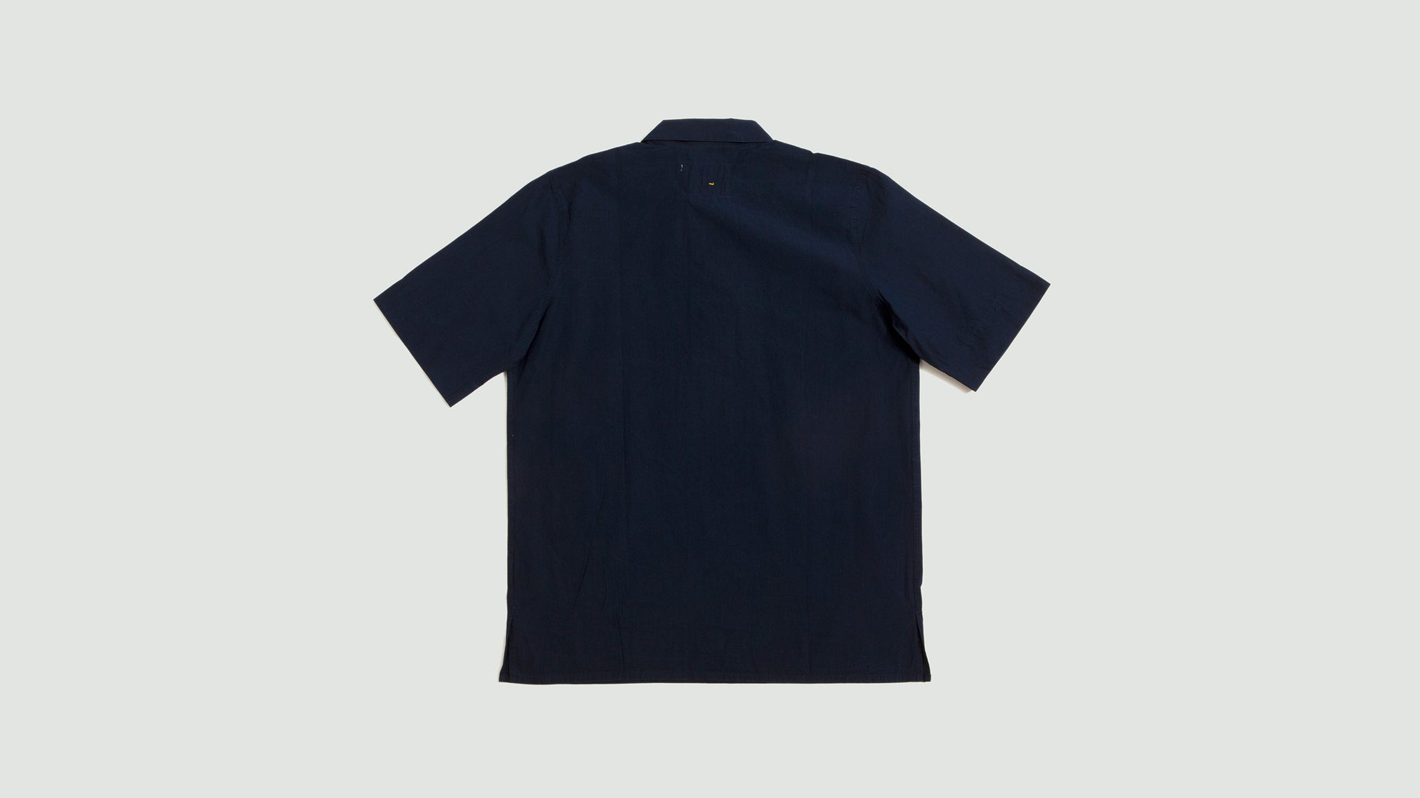 Margaret Howell. Wide placket polo shirt poplin indigo