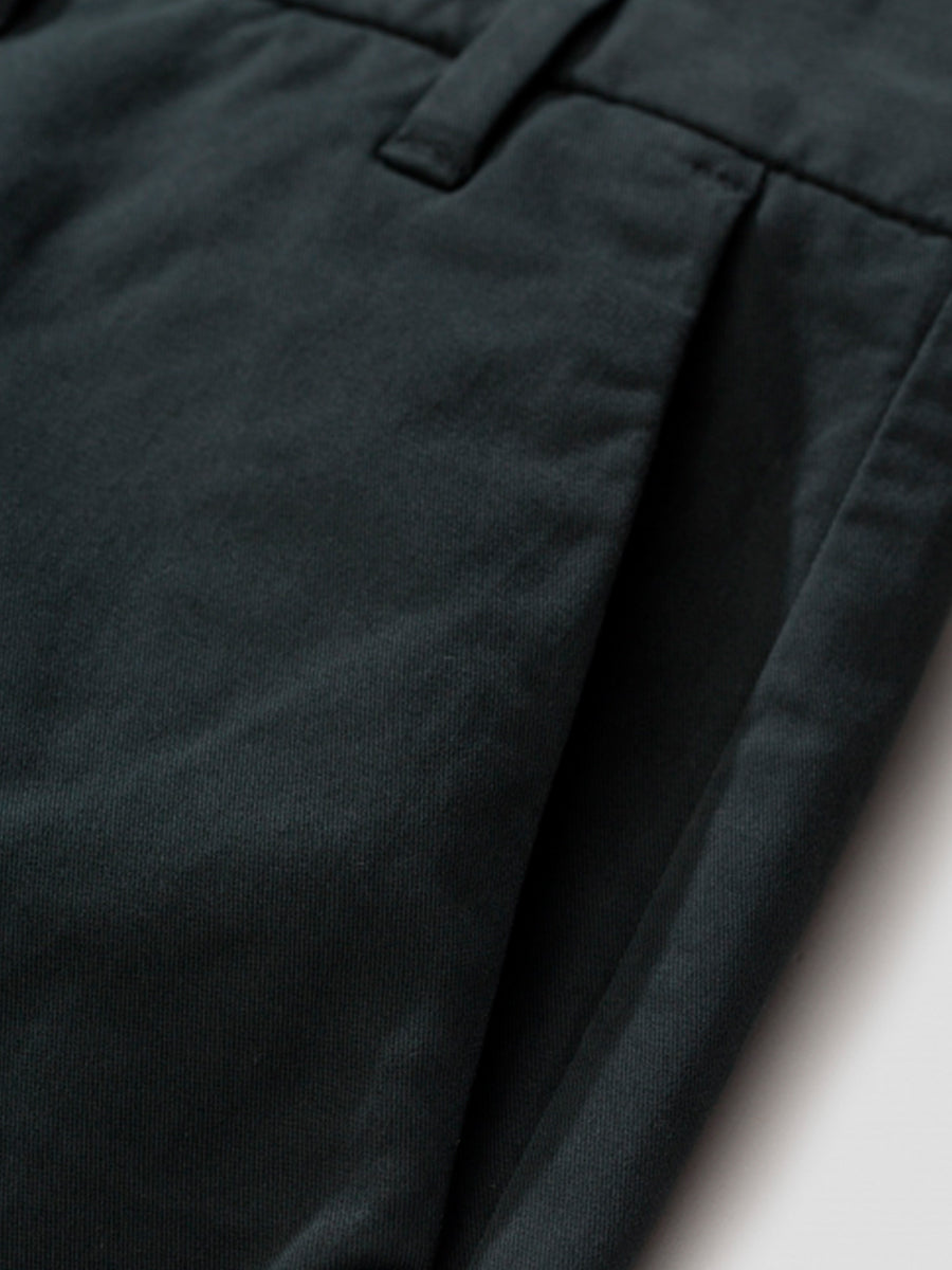 Aros slim strecth trousers in moss by Norse Projects